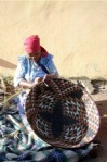 South African lady weaving a basket