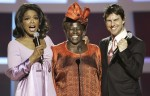Oprah Winfrey and Tom Cruise congratulating Wangari Maathai on her Nobel Peace Prize