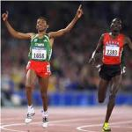 Haile Gebrselassie, of Ethiopia, defeating Paul Tergat of Kenya in the 10000 m run at the Sydney 2000 Olympics