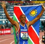 Frankie Fredericks raising the flag of Namibia