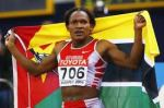 Maria Mutola raising the flag of Mozambique