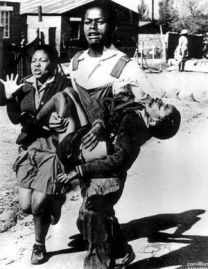 Hector Pieterson being carried away by Mbuyisa Makhubo, with his sister running alongside (Photo by: Sam Nzima)