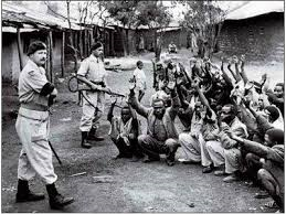Under British guns, during the Mau Mau rebellion in Kenya
