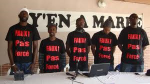 """The group """"Y'en a Marre"""" with their shirts """"Faux pas Force"""""""