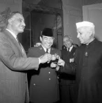 Nasser, Sukarno, and Nehru celebrating the success of the conference in 1955