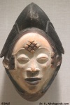 Diamond and Rectangular patterns on the forehead and temple area on a Tikar mask from Cameroon (exposed at the MET)